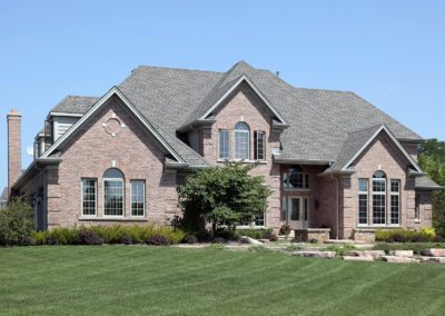 Luxury Brick Home With Stone Landscaping